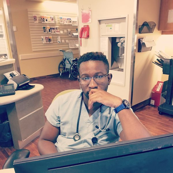 Tolu during a shift at the hospital where he practices